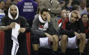 Boozer, Belinelli, and Noah on the bench, getting a taste of how difficult it is to watch this team play.